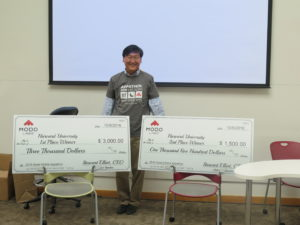 Andrew guarding the big checks!