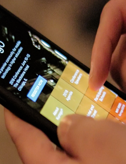 Photograph of Kurogo event app in use on a phone