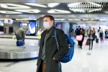 man wearing mask at airport