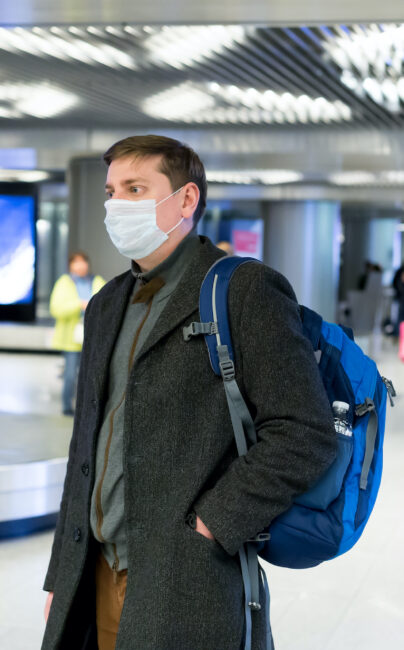 man wearing mask at airport